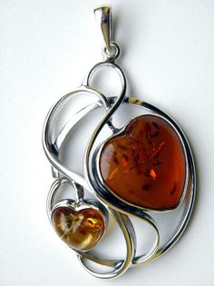 Pendant heart - silver and baltic amber Weight: 23 g Length: cm Width: 4 cm * design idea 2 hearts mother & child Amber Jewelry, Heart Jewelry, Stone Jewelry, Jewelry Art, Jewelry Design, Amber Heart, Stone Heart, Jewelry Photography, Modern Jewelry
