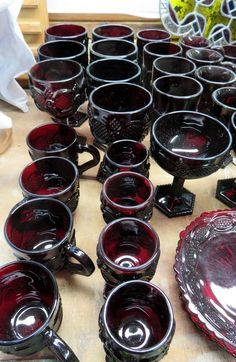Red Avon glasses, candlesticks, bowls, plates, red vases, smalls, horn carving set plus smalls.