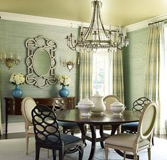 the green walls and turquoise lamps and blue chairs are delish!  i LOVE a round dining room table!