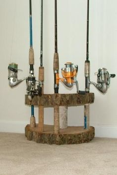 Rustic Home decor Fishing Rod Reel Holder Birch wood Log Tree Slice Cabin pole display Pool cue stand. $40.00, via Etsy. by angelia