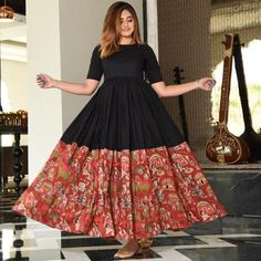 - all new, all you ❤️ Styled with all-over traditional motifs, this kalamkari print panel cotton dress redefines elegance. Cotton Dress Indian, Cotton Gowns, Dress Indian Style, Cotton Frocks, Cotton Long Dress, Cotton Skirt, Long Gown Dress, Frock Dress, Kurti Designs Party Wear