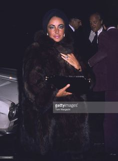 Elizabeth Taylor and boyfriend Dr. Lou Scarrone leaving his Eastside townhouse.