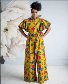 Be fun & flirty in the lovely Daia Afia Jumpsuit. This gorgeous outfit has piping in the neck and sleeve, a center back zipper, and lined bust. Find African print fashion at Kuwala. African Print Jumpsuit, Ankara Jumpsuit, African Print Dresses, African Dresses For Women, African Wear, African Attire, African Women, Ankara Gowns, African Outfits