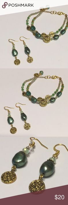 Green Freshwater Pear Bracelet & Earrings Set Lustrous freshwater pearls in pine green with their natural irregular shapes give this bracelet an artsy earthier feel.  The Antiqued gold really accentuates the pearls and harmonizes well with the smaller, delicate crystals and tiny 2mm prenite  gemstones. JK Designs Jewelry Bracelets