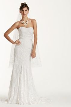 711a7ab4bb Be picture perfect in this ultra feminine lace gown! Strapless sheath gown  features gorgeous all