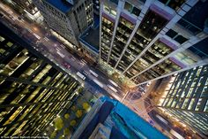 Head for heights: Thrillseeking photographer Tom Ryaboi took this shot from the roof of a skyscraper, high above the streets of Toronto