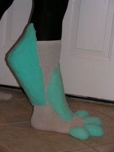 Wolf feet idea (socks, foam, hot glue, possibly some craft paint, and fake fur) these would be cool to make one day