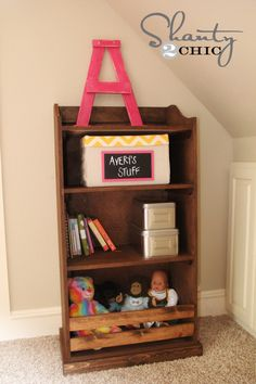 DIY Storage Bookcase at Shanty-2-Chic.com // Perfect storage solution for the kids rooms!