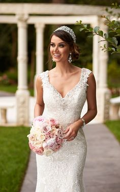 Layered Diamante embellishments adorn the sweetheart neckline of this sexy column wedding dress from the Stella York designer collection. #weddingdresses #SoStella