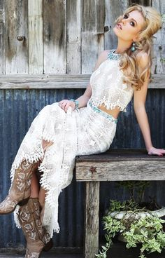 Be a boho beauty with Sherri Hill 32255! This stunning dress is great for formals like prom, sorority functions, galas, parties and more. Designed with perfect southern lace, this dress has a cropped silhouette and floor length skirt. The skirt features a double layer of lace that adds a feminine flavor that we adore for prom. Such an elegant look with a trendy vibe that we love for all formal occasions!