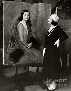 Pola Negri looks on with approval at a portrait of herself painted by Tade Styka. (Bizarre Los Angeles / Sad Hill )