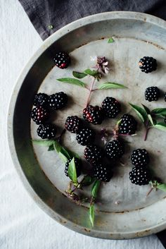 breakfast quinoa flakes w/ maple-stewed blackberries + basil flowers   dolly and oatmeal