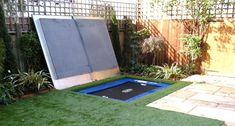 The real 'pièce de resistance' is the concealed trampoline which is underneath the artificial lawn. It has a bespoke lid, exclusively design. Sunken Trampoline, In Ground Trampoline, Backyard Trampoline, Small Garden Ideas With Trampoline, Small Garden Play Area Ideas, Trampoline Ideas, Backyard Toys, Trampolines, Outdoor Spaces