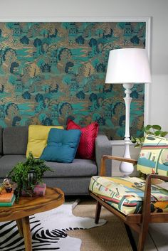 Colorful vintage, modern living room with graphic wallpaper background.