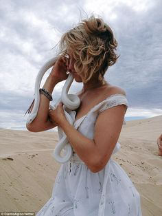 Wild! Dianna Agron tweeted an image of herself holding a snake in-between takes of her new movie Bare