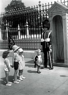 Buckingham Palace;-  Grenadier Guardsman on sentry duty outside Buckingham Palace suffers in the July 1933 heat wave.