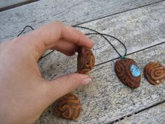 You can carve avocado pits to make pendants (how clever!). If you inlay additional jewelry components, the avocado will shrink around them and hold them in place when it dries out. When your creation has had enough time to completely dry, finish with wax, varnish, or leave natural. Your skin oils will eventually create a lustrous finish on their own.