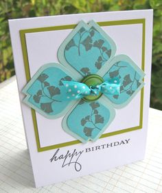 handmade card ... medallion/flower made of modified punched sqares ... gingko leaves stamped on petals ... like the strong, clean lines on this card ...