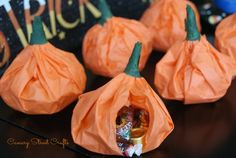 Easy DIY Pumpkin Pouch Goodie Bags!  fall halloween treats. Super easy pumpkin pouch goodie bags made from tissue paper. Just fill with your favorite candy. Perfect for a Halloween party!
