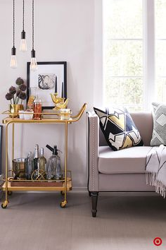 Refresh your living room for fall with a metal bar cart and a mix of high-contrast neutrals. Roll in the bar cart to double as an end table and, of course, a bar, adding candles, art and other decor in a mix of metals and neutral hues. Introduce a simple pattern, like these black and white geometric pillows, to add interest while maintaining the understated feel. Hang a grouping of three single pendant lights to push the look a step further without overcrowding the space.