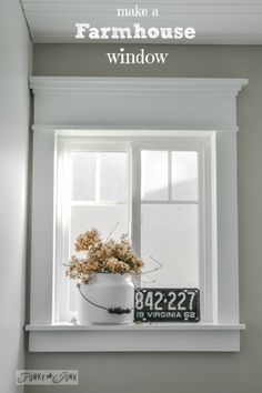 How to make a farmhouse window with moulding / How to plank a bathroom ceiling with pine planks - full tutorial via http://www.funkyjunkinteriors.net/