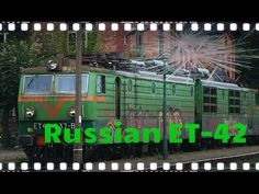 Russian ET42 electric locomotiv with heavy wagons on a railroad crossing - YouTube