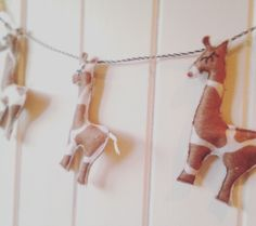 Giraffe wall hanging, garland, bunting, safari nursery, neutral nursery, baby decor, mobile, three felt giraffes by Thesecretcrafthouse on Etsy https://www.etsy.com/listing/264067448/giraffe-wall-hanging-garland-bunting
