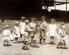 Young boys and girls on the baseball field at a major league stadium: taken between 1910 and 1930