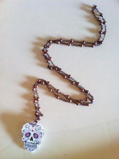 collana calaveras:teschio calaveras con catena color rame