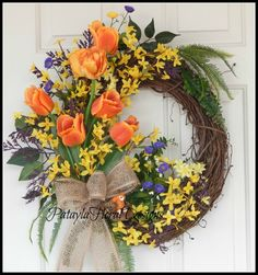 Grapevine Wreath with Bird and Bird Nest, Spring Easter Wreath with Forsythia, Front Door Orange Tulip Wreath, Outside Floral Wreath by PataylaFloralDesigns on Etsy https://www.etsy.com/listing/219779793/grapevine-wreath-with-bird-and-bird-nest