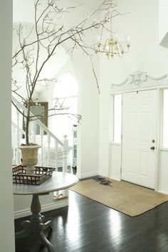 I love the molding over the front door. I'd love to have the same thing over mine. Also I'm in love with the floors.