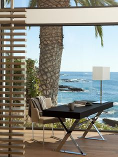 Working from home feels like a vacation when your workspace is juxtaposed with epic views. Seamless windows enhance the feeling of being outdoors in this modern home office.