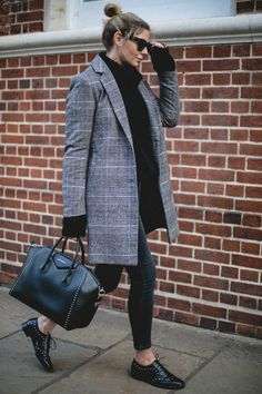 Emma Hill wears check coat, studded Givenhcy Antigona bag, black skinny jeans, black patent studded brogues, Celine baby Audrey sunglasses, chunky knit jumper, everyday winter outfits