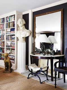 A huge bust of George Washington and an enormous framed mirror make a small room feel grand.