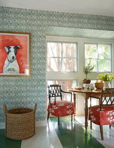Painted floor, interesting green wallpaper, slipcovered chairs, dog art, quirky kitchen