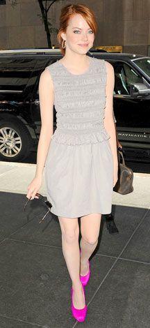 I love the neutral mini ruffled dress and the bright fushia colored pumps that POP<3