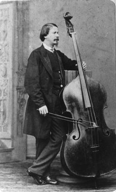 Giovanni Bottesini, composer, with hisTestore double bass. From Wikipedia.