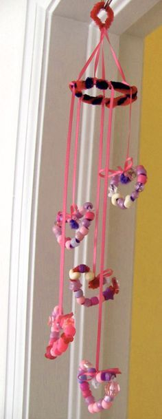 Kids Craft: Beaded heart Mobile. This is a Valentines craft but I think some little girls might want it hanging in their room all year round.