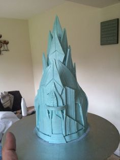 Default - Work in Progress - Frozen Ice Castle for large mountain cake...This is only a topper, so the base is a small polystyrene dummy tier with a polystyrene cone attached. They then covered the whole thing in candy clay and attached all the pieces you can see to it.