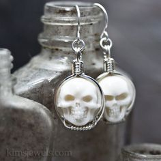 Carved Cow Bone Round Skull Cameo Sterling Silver Wire Wrapped Earrings. $45.00, via Etsy.