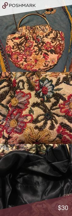 Vintage Beaded Purse Vintage Beaded Purse Arched handles with Multi colored Floral beaded and Scrolled Chain!!  excellent condition !!! Gorgeous vintage multi colored   on glial fabric. This purse has a double brass handles with a unique side clasp and a scrolled shoulder chain,  Pursr is 7 in tall x 9 in wide and 2 in deep ... Chain strap is 24 in long.  Purse lining clean and nice! true vintage Bags Shoulder Bags