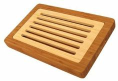 """Bamboo Crumb Board by Table Top by Kitchen Collection. $49.00. Bamboo Crumb Board by Table Top. Bamboo Crumb BoardA very unique cutting board! Made entirely of bamboo, this board has two pieces. Use it to slice bread and it catches the crumbs, keeping your workspace tidy. Lift out the top board and toss the crumbs away. Easy! Makes a great hostess gift.Made of bamboo; measures 14 1/2"""" by 9 3/8"""" by 1 1/2."""" Hand wash only."""