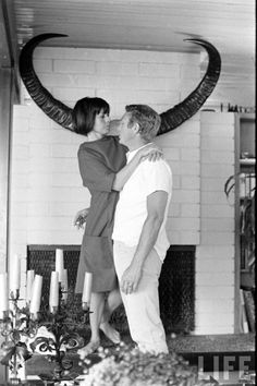 Steve McQueen and Neile Adams McQueen (1st wife) at home.
