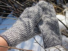 Two-end knitted mittens with hook-stitch pattern.