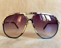 Alpina M1 22662366 C-2G Grey/Silver/Gold Vintage Sunglasses including Alpina Flip-Open Case Made in West Germany in the 1980s Frame and lenses are in new unworn deadstock condition (New Old Stock), all inner temple markings intact and flawless. Including original Alpina flip-open
