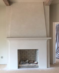 Wondering if this works in family room? Tying in shape of range hood to family room fireplace? Stucco Fireplace, White Fireplace, Fireplace Remodel, Modern Fireplace, Brick Fireplace, Fireplace Design, Fireplace Surrounds, Transitional Fireplaces, Two Story Fireplace