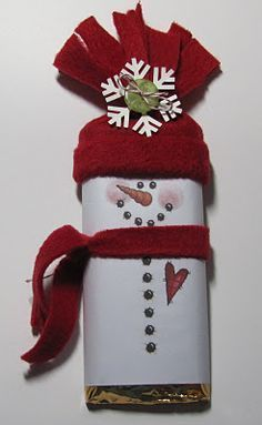 snowman candy bar cover... Printable wrapped around candy bar/individual popcorn bag. These were not nearly as difficult to make as they look!