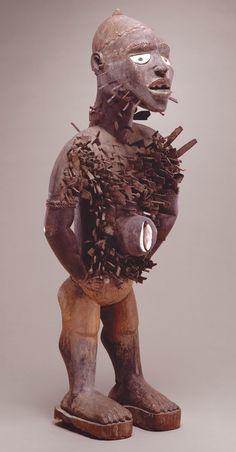 Power figure (Nkisi n'kondi). Kongo peoples (Democratic Republic of the Congo). c. late 19th century C.E. Wood and metal. Detroit Institute of Arts.