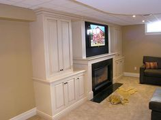 Cabinets around a fireplace
