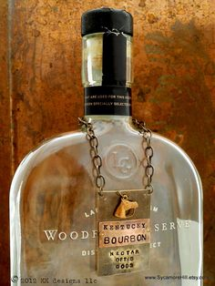 The  Bourbon Bottle Tag Collection  The Riveted Series by Sycamore Hill, $44.00 Copyright 2012 Artist Kelly Galanos KK designs layered copper brass metals hand stamped handmade with vintage equestrian horse horse racing charm
